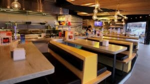 An example of Corian integeration into bespoke booth seating and solid surfaces used in restaurants
