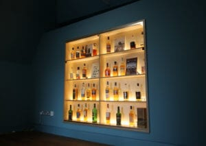 Bespoke glazed presentation cabinet and shelving by Allstar Joinery