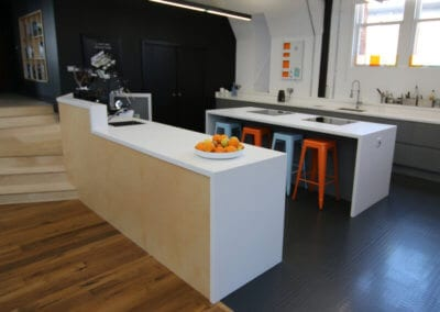 Kitchen work area completely cladded with solid surface Corian� worktops