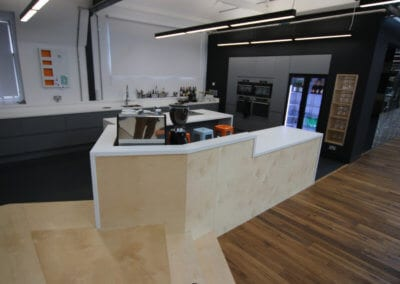 Kitchen work area completely cladded with solid surface Corian� worktops and integrated appliances