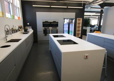 Kitchen work area completely cladded with solid surface Corian� worktops. Bespoke manufacture and fit-out